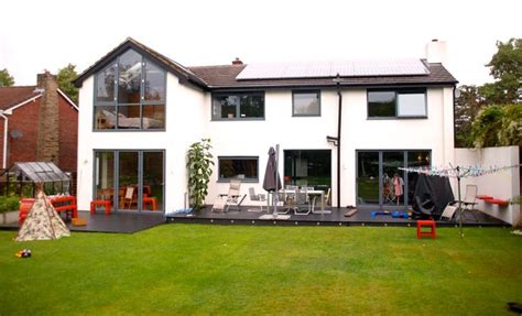 white house windows finished build aluminium windows and bi fold doors give house new lease of life with