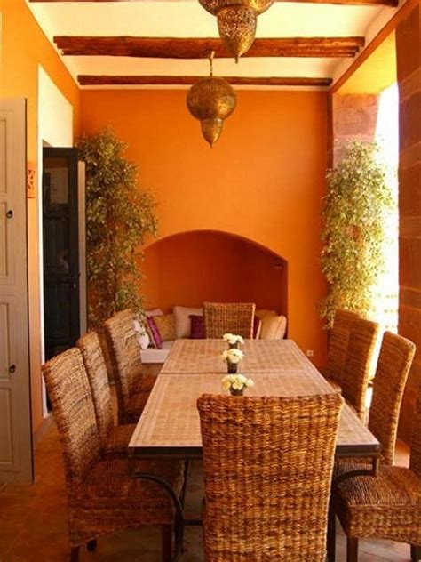 classic outdoor moroccan dining room design with rattan chairs orange wall paint simple rattan