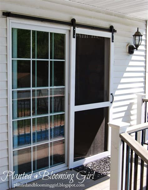 exterior doors with screens planted and blooming sliding screen door