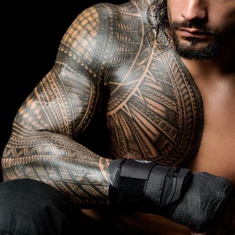 roman tattoo history the 50 coolest tattoos in wwe history photos wwe