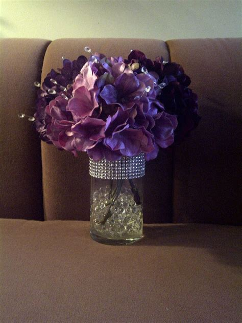 Centerpieces: 3 different color purple Hydrangeas, water