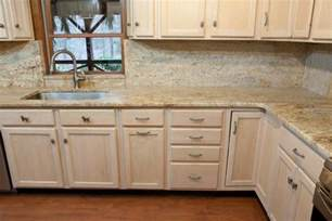 light maple cabinets with granite countertops