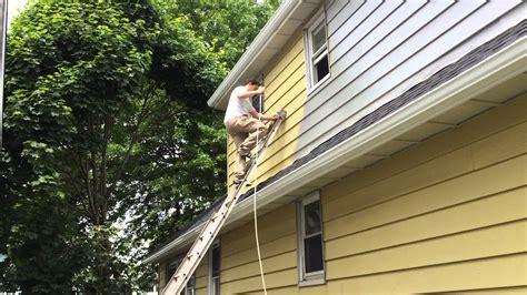 spray paint house spray painting an exterior of the house