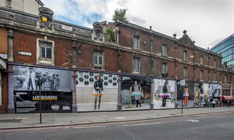 crossrail construction site hoardings undergo a make over come face to face with giant londoners in smithfield