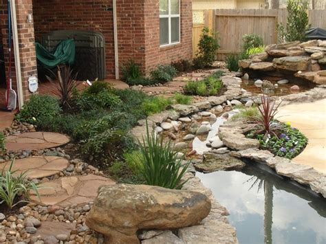 Backyard Creek by Landscaping With Oversize Pavers And Backyard Creek Hkns