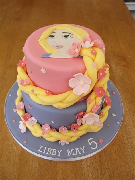 a two tier rapunzel cake 6 and 8 inch round cakes with her hair wrapped around the two tiers my