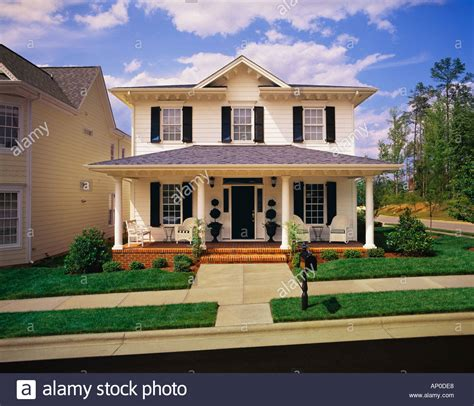 Two Story House small two story white house with black shutters brick