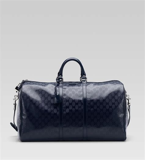 Gucci Duffle Bag gucci large carry on duffel blue gg imprim 233 s bags