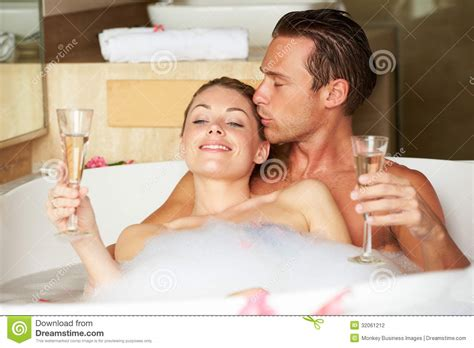 couple bathtub couple relaxing in bath drinking chagne together stock photography image 32061212