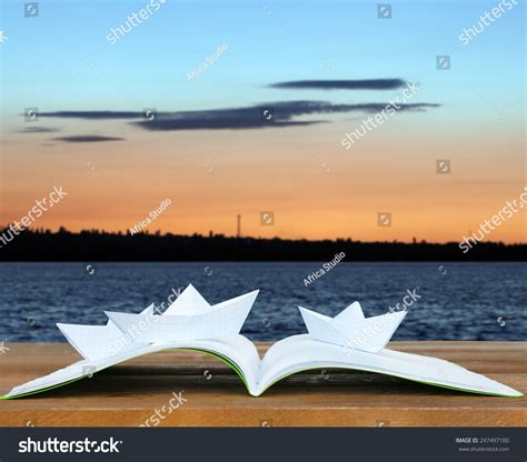 origami boat book origami boats on book on nature stock photo 247497100