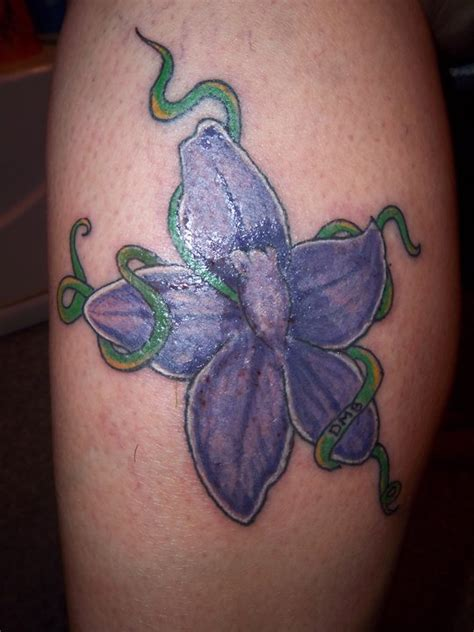 larkspur flower tattoo by artgunluver on deviantart