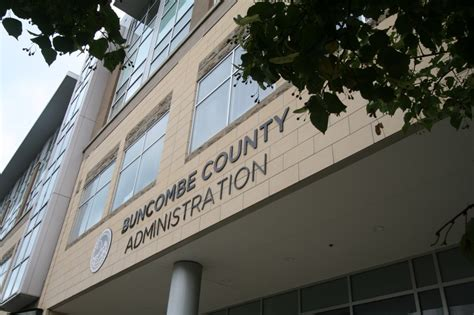 phoning it in commissioners negotiate tax rate in