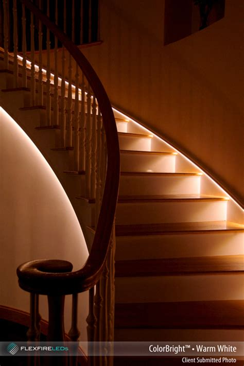 Wonderful Colored Led Christmas Lights #9: Indirect-led-lighting-strip-light-stairway-stairs-side-brown-white-colored-curved-wooden-material-holder-glossy-brown-stripe-wall.jpg