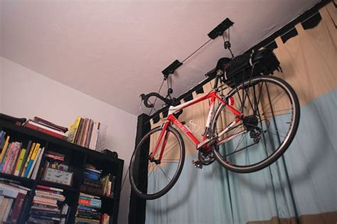 bike hanging from ceiling spaces pinterest