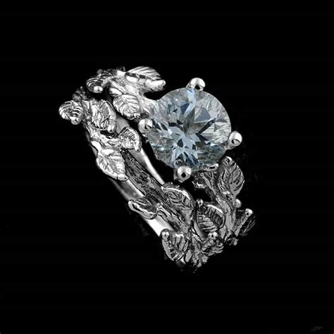 White Gold Hand Crafted Leaves Aquamarine Center