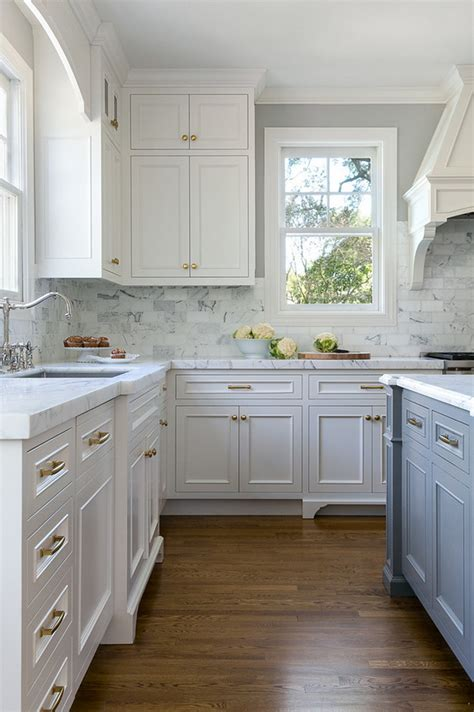 white kitchen with stacked cabinets and grey island home bunch interior design ideas