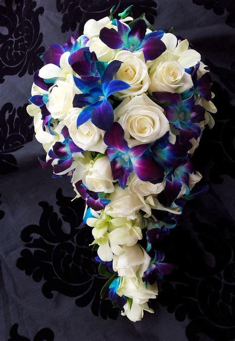 white rose  blue orchid bouquet wwwfbdesigncomau
