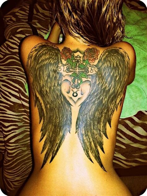 cross and wings back tattoo black wings with roses and cross on back