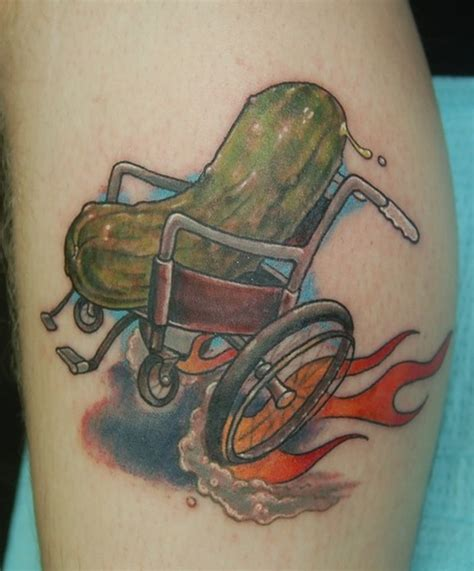 tattoo of us wheelchair pickle in a wheelchair by shawn hebrank tattoonow
