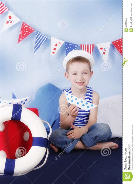 Sailor Boy sailor boy sitting with steering wheel in marine decor