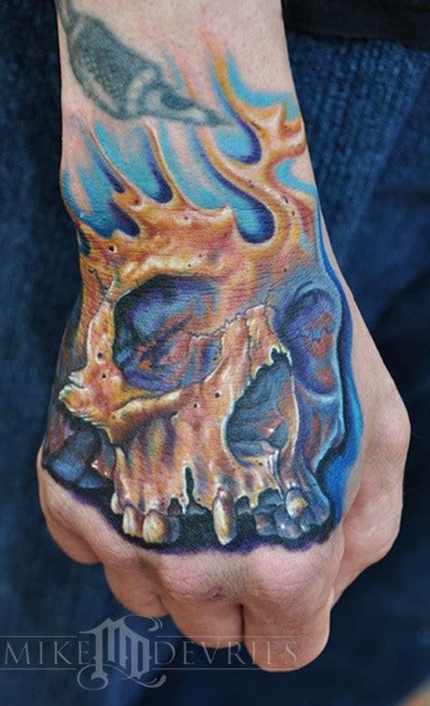 skull tattoo by mike devries tattoos