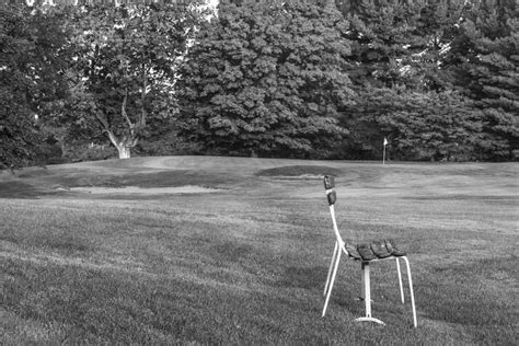 mcgraws bench bench on golf course black and white photograph by john mcgraw