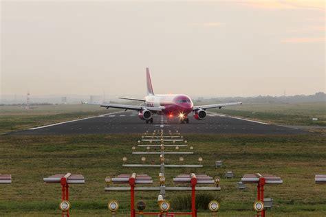wann spätestens am flughafen sein instrumentenlandesystem ils dortmund airport