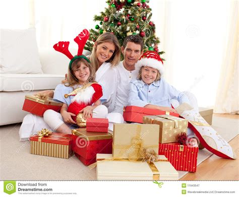 christmas gift opening ideas happy family opening presents stock image image 11943547