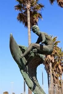 City Duvet Cover Huntington Beach Surfer Statue Photograph By Paul Velgos