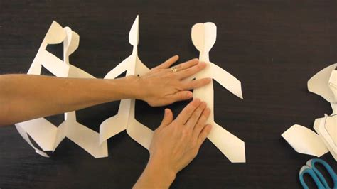 How To Make String Of Paper Dolls - how to make paper dolls holding