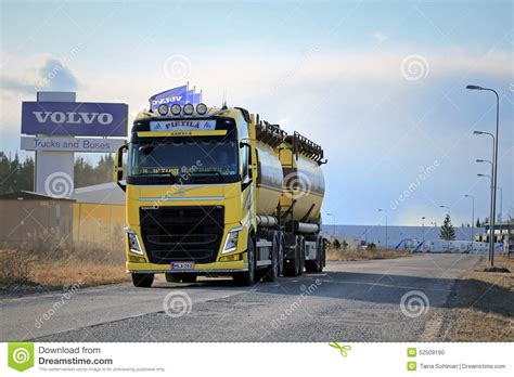volvo heavy duty yellow volvo fh tank truck on the road with volvo trucks