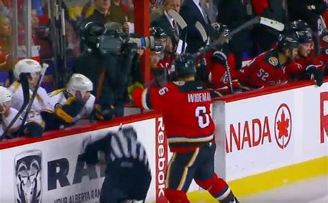 hit the bench flames dennis wideman cross checks linesman into boards ny daily news