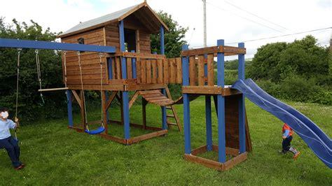 wooden swing set with bridge deluxe tree house with bridge link slide swings ref 087t