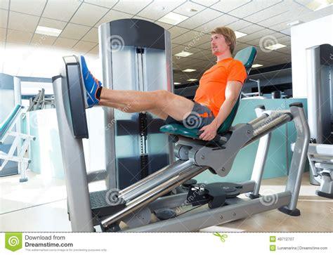 seated leg press machine workout seated leg press machine blond workout stock image
