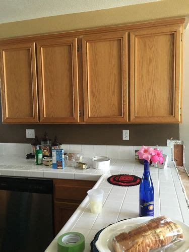 can i stain my kitchen cabinets should i re stain or paint my cabinets hometalk