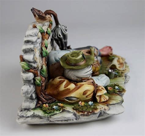 capodimonte tr on bench with wine bottle capodimonte cortese 331 naples rare porcelain figurine