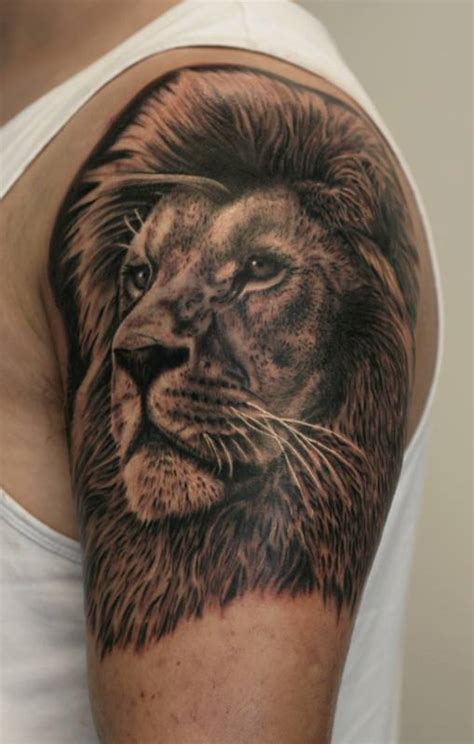lion shoulder tattoos for men grey ink on left shoulder by anders grucz