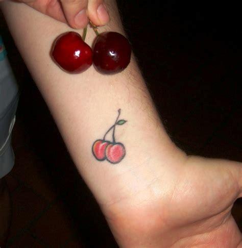 small cherry tattoos small cherries on wrist