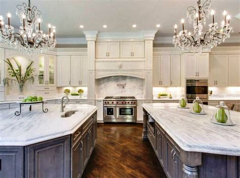 beautiful kitchen with white cabinets two islands two