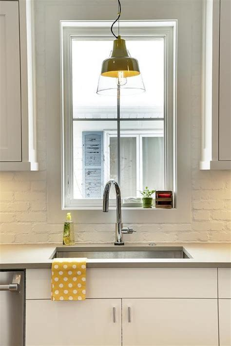 white painted brick kitchen backsplash transitional