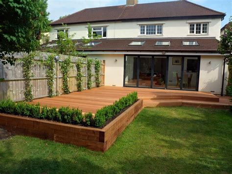 Garden Deck Ideas Elevated Garden Angled 145mm Balau Smooth Hardwood Decking With Raised Beds Made From Railway