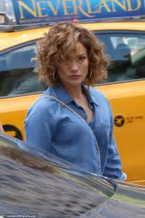 j lo hair new short curly 2014 jennifer lopez legs it to lunch in a short romper as she