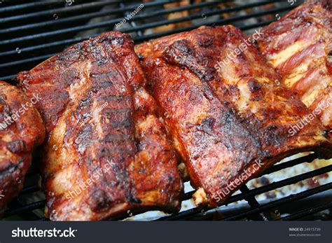 barbecue pork ribs on a grill stock photo 24915739 shutterstock