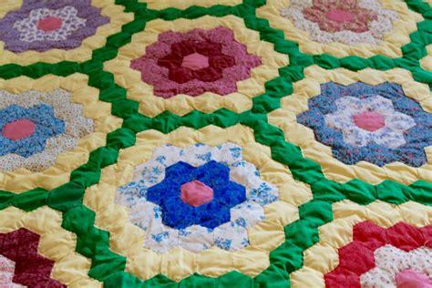 grandmothers flower garden quilt pattern yellow and green grandmother s flower garden quilt