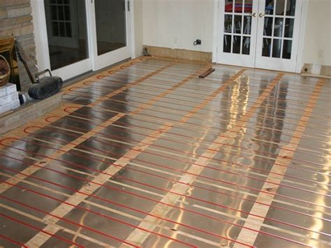 roth heated floor soak up the warmth of a radiant hydronic heat system in