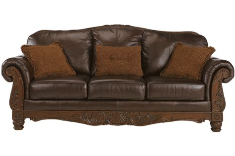leather wood sofa traditional leather sofa with show wood accent by ashley