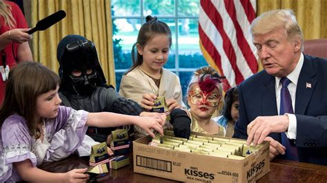 trump hosts white house reporters kids for oval office trump hosts reporters kids for halloween asks if they ll