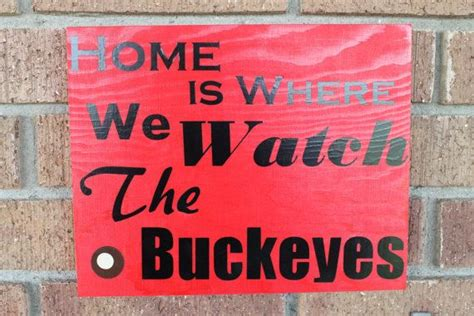ohio state buckeyes home decor ohio state wall decor home is where we watch the buckeyes home wooden signs and we
