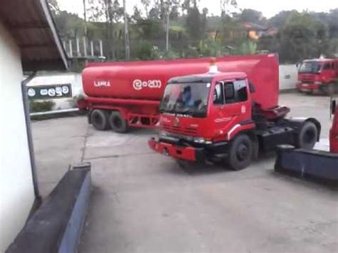 fuel truck driver makes an extremely sharp u turn in front of a safety sign