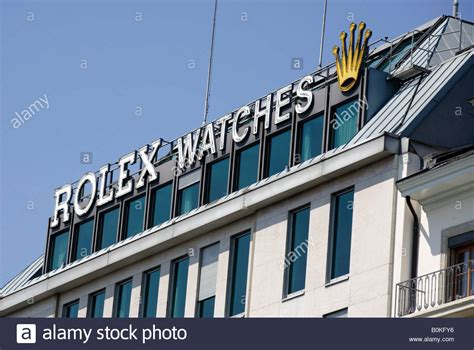 stock photo company the rolex watches sign on top of the company s building in